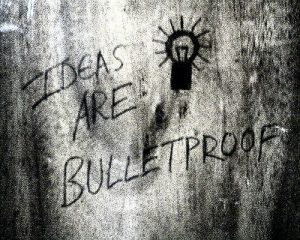 "Graffiti reading ""Ideas are bulletproof"""
