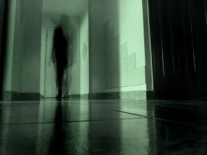 Ghostly figure in a hallway