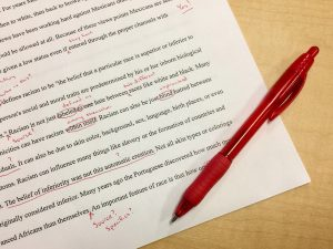 Red pen and edited manuscript