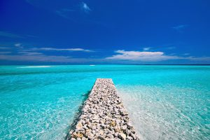 Rock pier into ocean waters