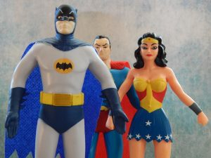 Action figures of Batman, Superman, and Wonder Woman