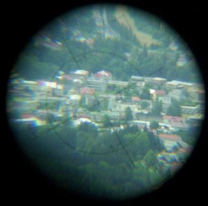 Village through a long-range scope