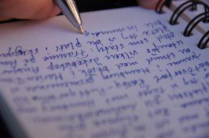 Handwritten text in a notebook