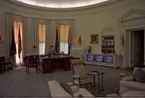 Lyndon Johnson watching TV in the Oval Office