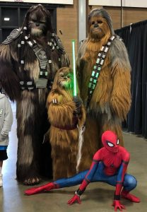 Two adult Wookie cosplayers, one child Wookie cosplayer, and a traditional Spider-Man cosplayer from Washington State Summer Con